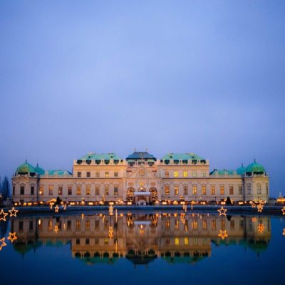 Picture of beautiful castle in Vienna which is reflected in the water at dusk