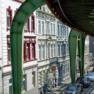 Floating railway in Wuppertal in front of house facades