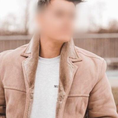 Bild eines netten jungen Mannes mit hellbrauner Jacke